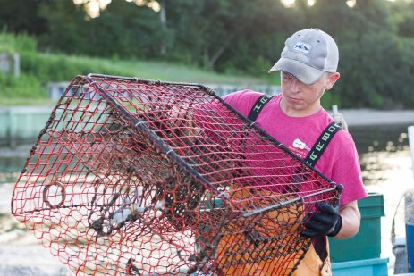 Ben Bruno of Endurance Seafood in Oriental, NC pulling crab pots.role=