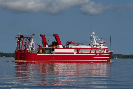Large commercial fishing vessel on the water.role=
