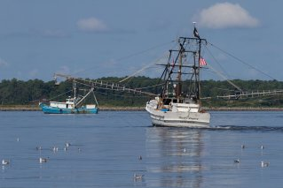 Two fishing trawlers working in the Pamlico Sound.role=