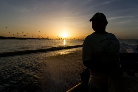 Zach Bruno of Endurance Seafood heading to work on boat at sunrise.role=